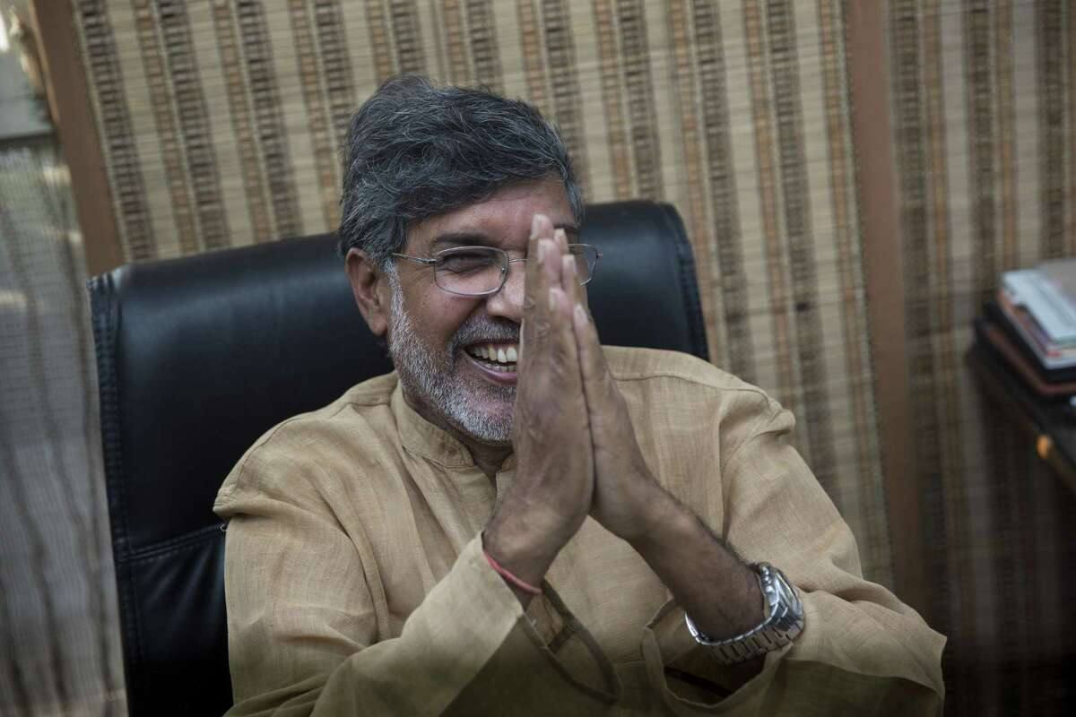 Indian children's rights activist Kailash Satyarthi gestures as he addresses the media at his office in New Delhi, India, Friday, Oct. 10, 2014. Malala Yousafzai of Pakistan and Satyarthi of India jointly won the Nobel Peace Prize on Friday, Oct. 10, 2014, for risking their lives to fight for children's rights. (AP Photo/Bernat Armangue)