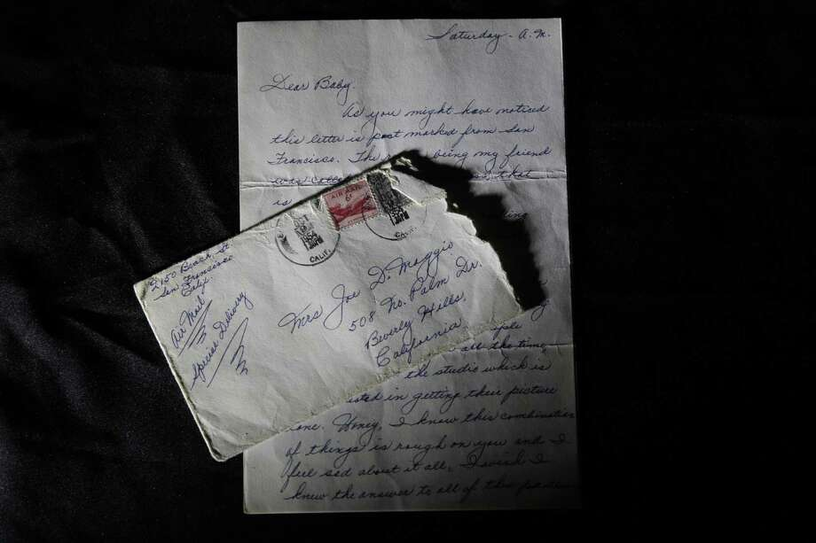 This Friday, Nov. 7, 2014 photo shows part of a three-page handwritten letter and original envelope postmarked Oct. 9, 1954 from baseball legend Joe DiMaggio to Marilyn Monroe on display at Julien's Auctions in Beverly Hills, Calif. Photo: AP Photo/Jae C. Hong, File   / AP