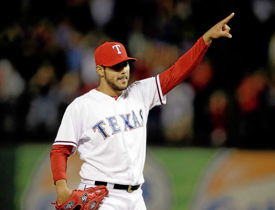 Rangers starter Martin Perez celebrates after getting the final out of his three-hit shutout against the Chicago White Sox on Friday in Arlington, Texas. Photo: Tony Gutierrez — The Associated Press   / AP