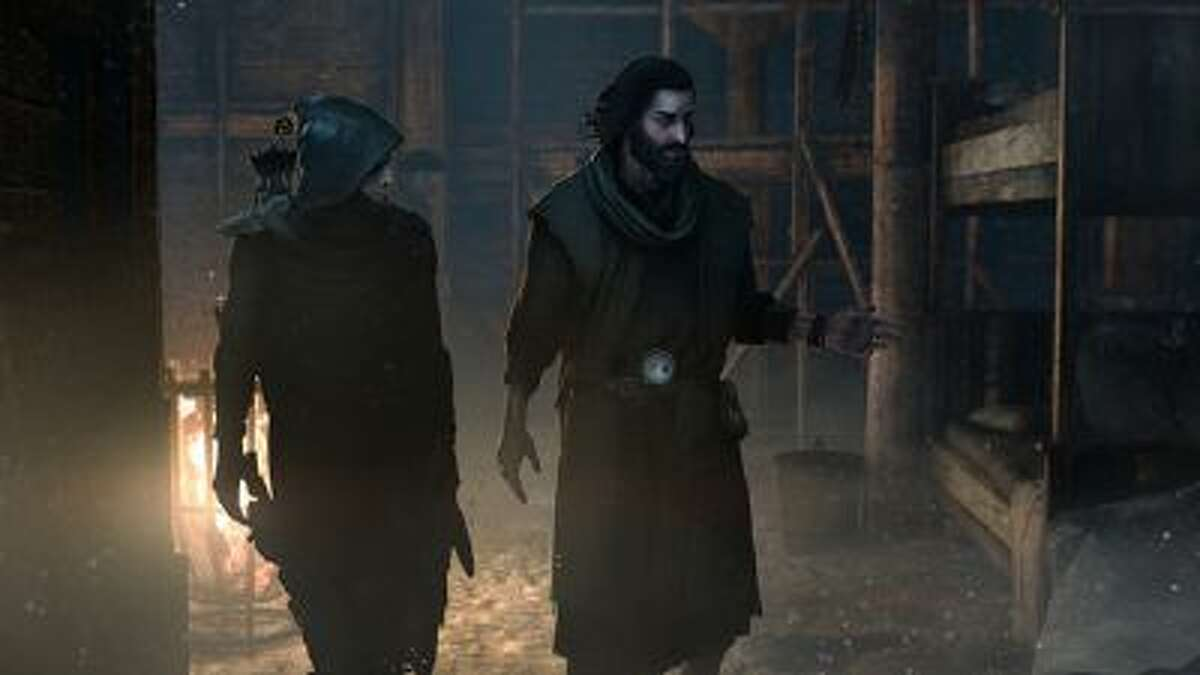 """Garrett, left, speaks with Orion, a vital ally, in the """"Thief"""" reboot."""