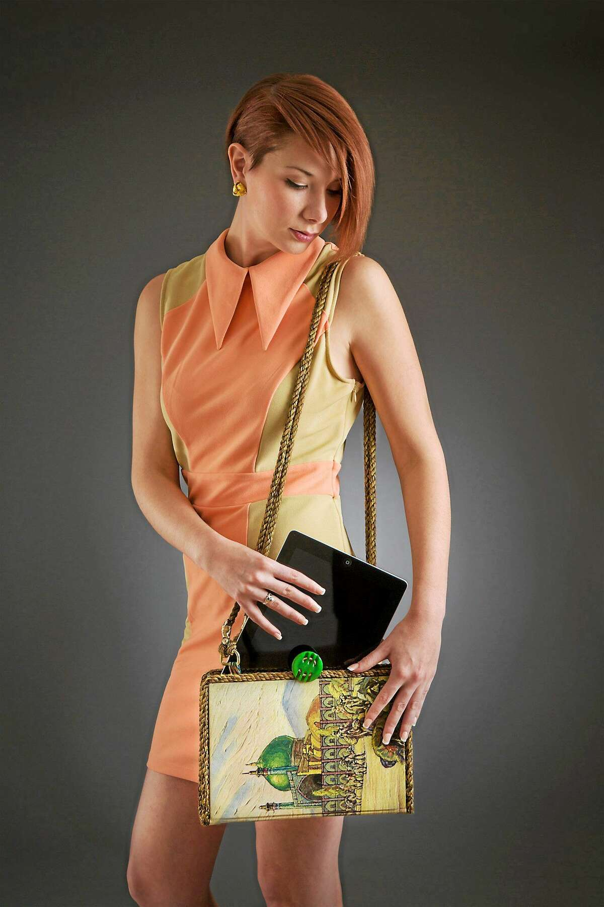 """contributed Coventry artist Kathleen Scranton's """"Haijj Babba,"""" iPad vintage shoulder purse made from a book published 1937."""