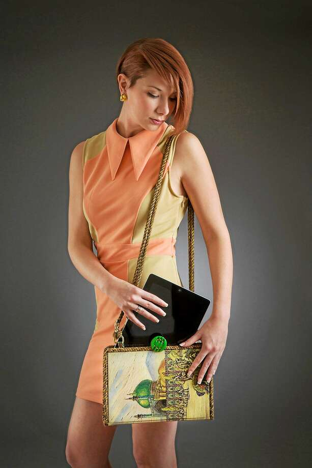 "contributed  Coventry artist Kathleen Scranton's ""Haijj Babba,"" iPad vintage shoulder purse made from a book published 1937. Photo: Journal Register Co. / Copyrighted Permission granted by Paradise City, Inc 2013 www.paradisecityarts.com"