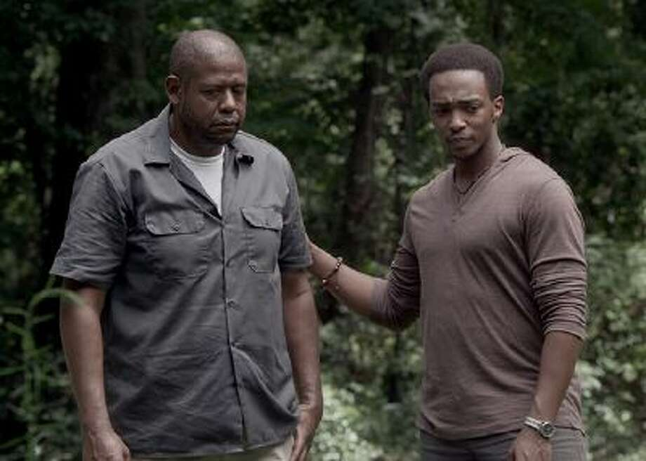 """This photo provided by Codeblack Films shows Forest Whitaker, left, as Angel and Anthony Mackie as Tommy, in a scene from the film, """"Repentance."""" He plays the role of the bipolar Angel Sanchez, who seeks private treatment from a spiritual adviser before taking him hostage in the basement of the home where he and his young daughter reside.  Whitaker took on a new challenge to grow in the psychological thriller which releases Friday, Feb. 28, 2014. (AP Photo/Codeblack Films, Patti Perret) Photo: AP / Codeblack Films"""