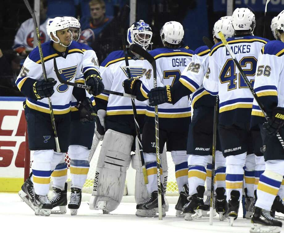 St. Louis right wing T.J. Oshie (74) and teammates congratulate goalie Martin Brodeur (30) after the Blues beat the New York Islanders 6-4 on Saturday in Uniondale, N.Y. Photo: Kathy Kmonicek — The Associated Press   / FR170189 AP