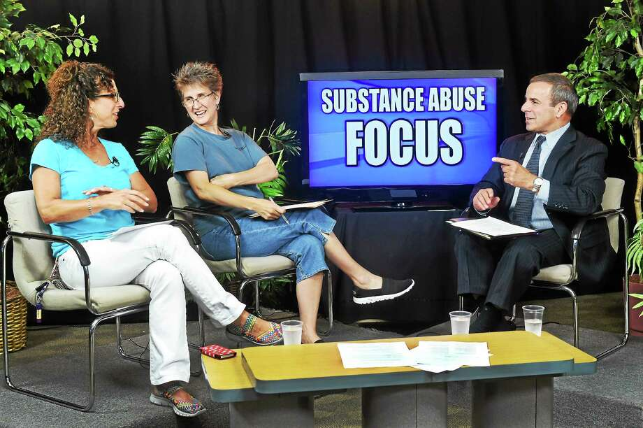From left, Joanne Hoffman; Mary Marcuccio, founder and CEO of My Bottom Line; and North Haven First Selectman Michael Frieda at the North Haven TV studio recently, taping one of a series of shows dealing with drug and alcohol abuse. Photo: Melanie Stengel — New Haven Register