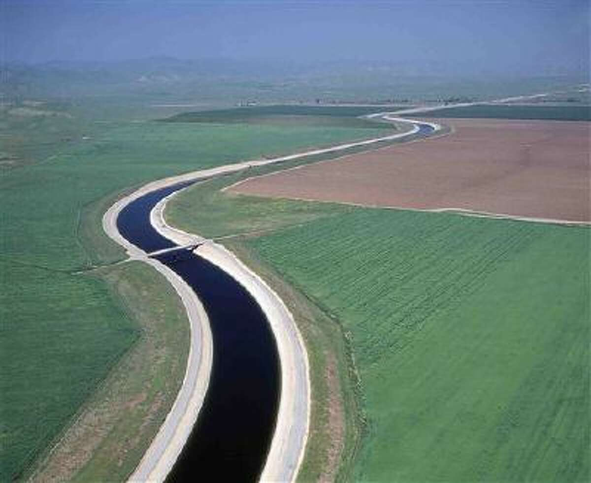 FILE -Water makes its way south through the Central Valley by way of the California Aqueduct in this undated handout photo. A judge orders the a giant Southern California water wholesaler to reset rates in response to claims that ratepayers in San Diego were subsidizing the rest of the region. (AP Photo/California Department of Water Resources, Dale Kolke, File)