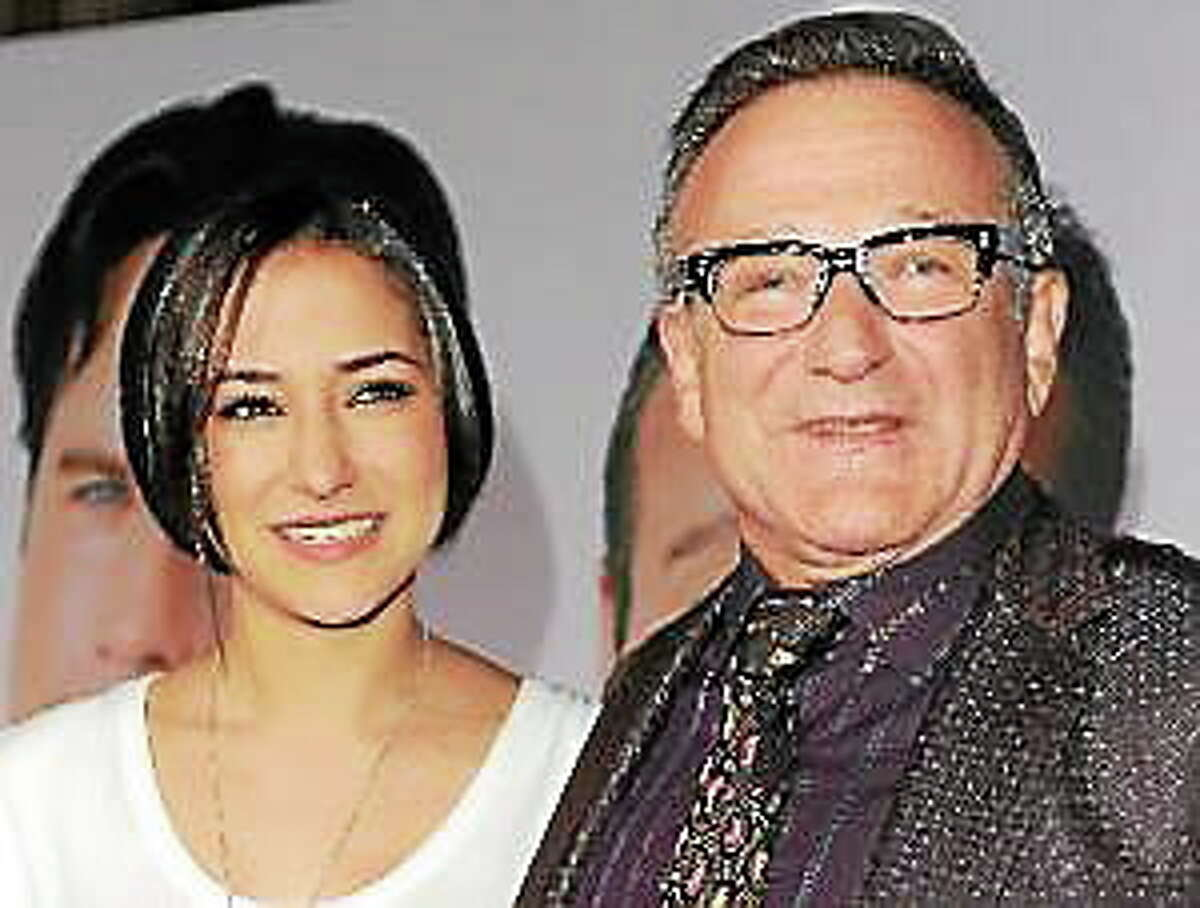 """This Nov. 9, 2009, file photo shows Zelda Williams, left, with her father Robin Williams at the premiere of """"Old Dogs,"""" in Los Angeles."""
