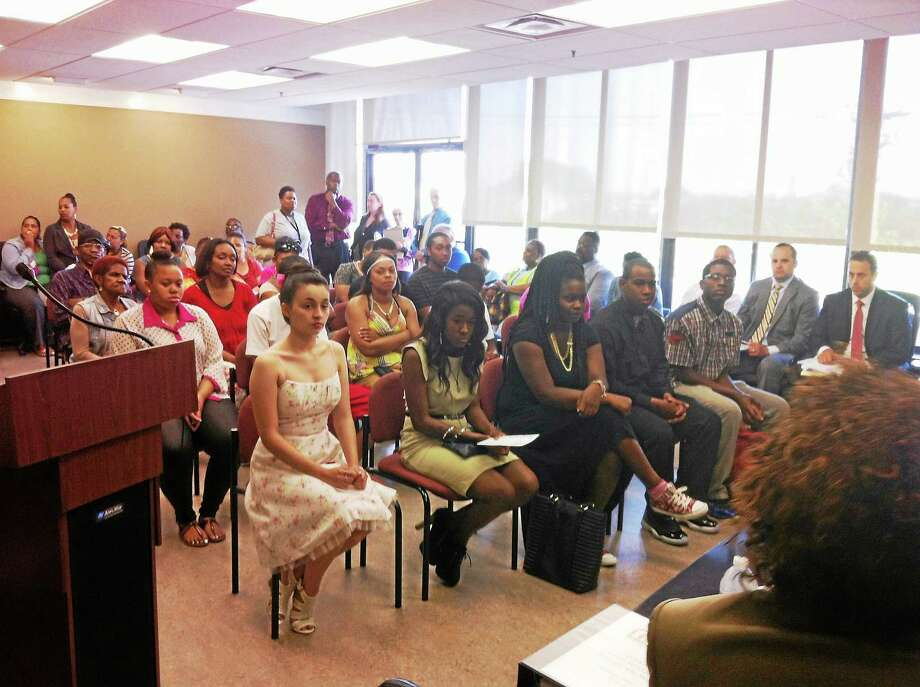 High School seniors from Elm City Communities/Housing Authority of New Haven recognized as class of 2014. Photo: Keldy Ortiz — NEW HAVEN REGISTER
