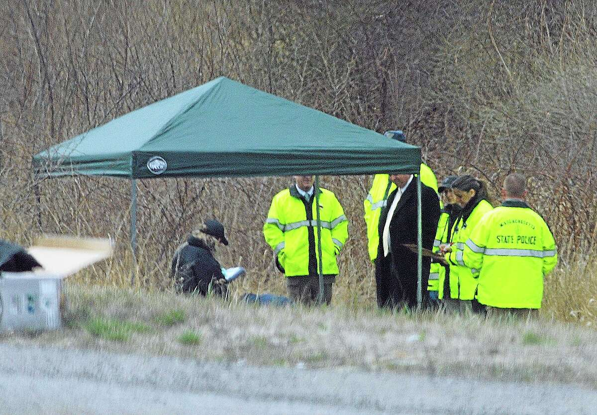 Massachusetts State Police stand along Interstate 190 where police said a child's body was found Friday near Sterling, Mass. Worcester County District Attorney Joseph Early Jr., said the body has not been positively identified as Jeremiah Oliver, of Fitchburg, but that the height and weight of the body was consistent with Oliver's size. Jeremiah Oliver was last seen by relatives in September 2013 but wasn't reported missing until December. His mother Elsa Oliver and her boyfriend Alberto Sierra are both charged in the case.