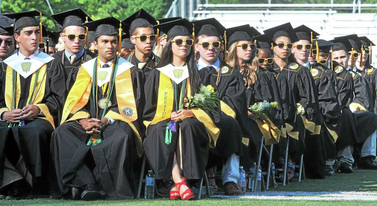 Jonathan Law High School seniors listen to speeches during graduation ceremonies Tuesday in Milford.