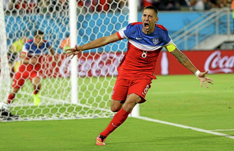 United States' Clint Dempsey celebrates after scoring the opening goal during the group G World Cup soccer match between Ghana and the United States at the Arena das Dunas in Natal, Brazil, Monday, June 16, 2014.  (AP Photo/Ricardo Mazalan) Photo: AP / AP