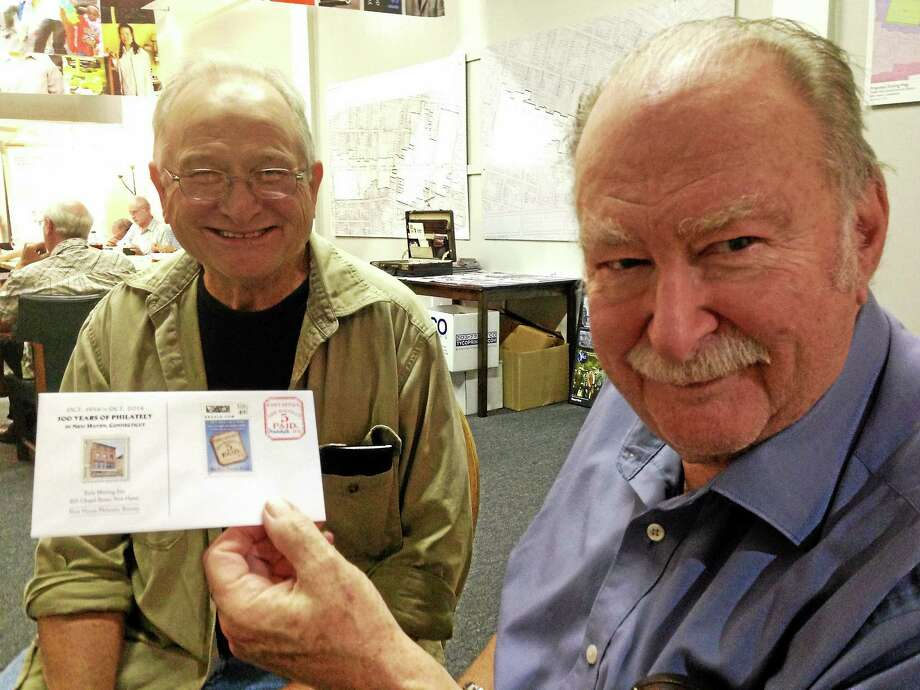 Frank Chasney, left, and Bob Eldridge of the New Haven Philatelic Society with the club's 100th anniversary cover. Photo: ED STANNARD — NEW HAVEN REGISTER