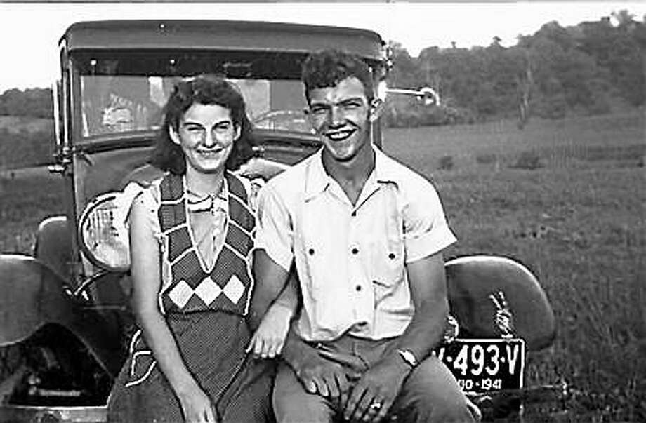 In this September 1941 photo provided by Dick Felumlee, Kenneth and Helen Felumlee pose for a photo nearly three years before their marriage in February 1944. The Felumlees, who celebrated their 70th wedding anniversary in February, died 15 hours apart from each other last week. Photo: Associated Press/Felumlee Family   / Dick Felumlee