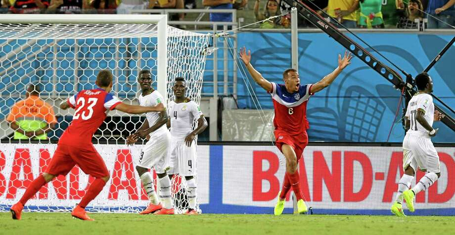 John Brooks, second right, celebrates after scoring USA's second goal against Ghana on Monday. Photo: Dolores Ochoa — The Associated Press   / AP