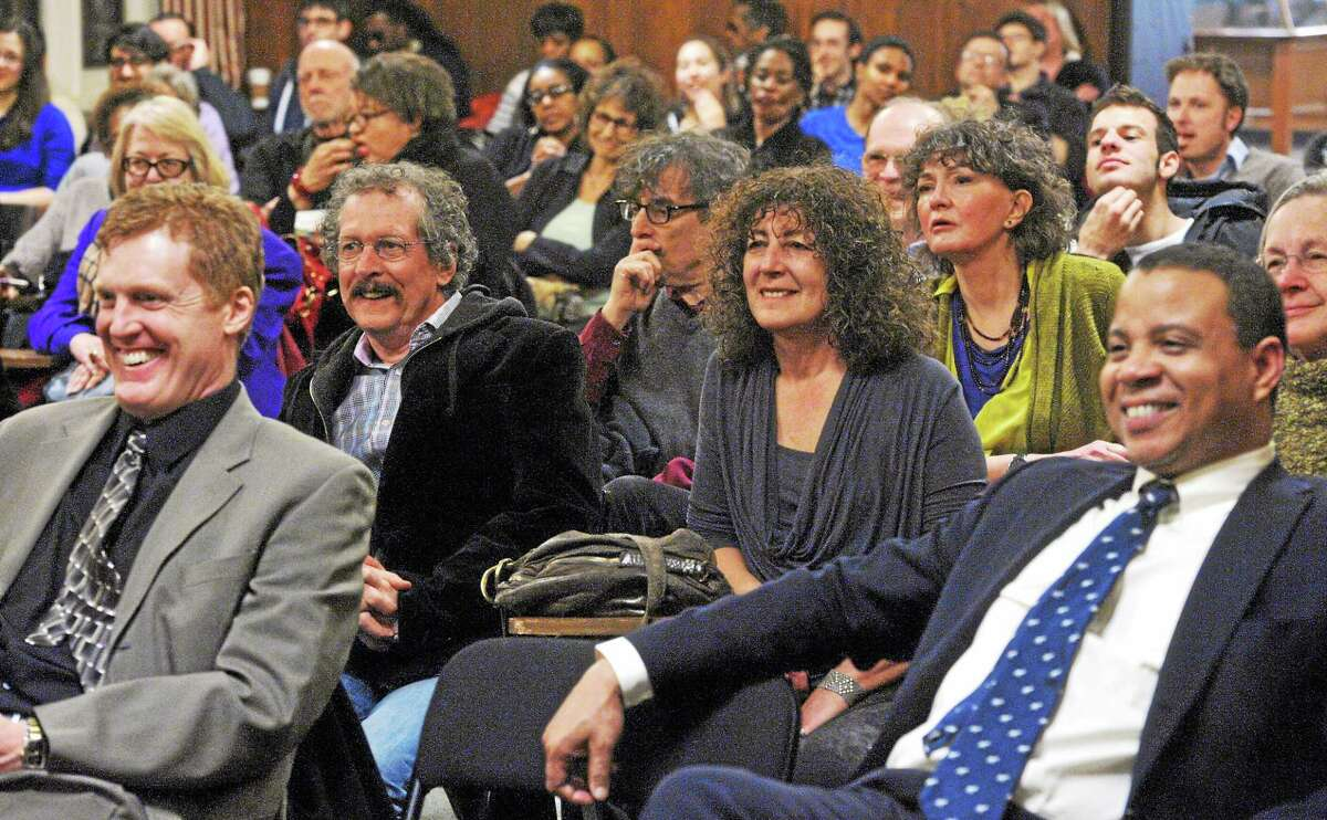 The audience reacts to comments made about J. Edgar Hoover, former head of the FBI, during a discussion Wednesday at Yale's Sterling Memorial Library.