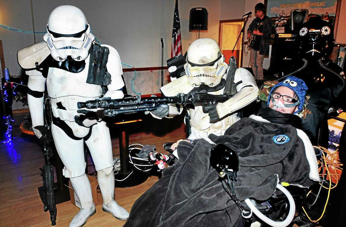 (Arnold Gold-New Haven Register) Jonathan Bowkowski (right) is escorted into his birthday party by Imperial Stormtroopers at the Irish American Community Center in East Haven on 4/19/2014.