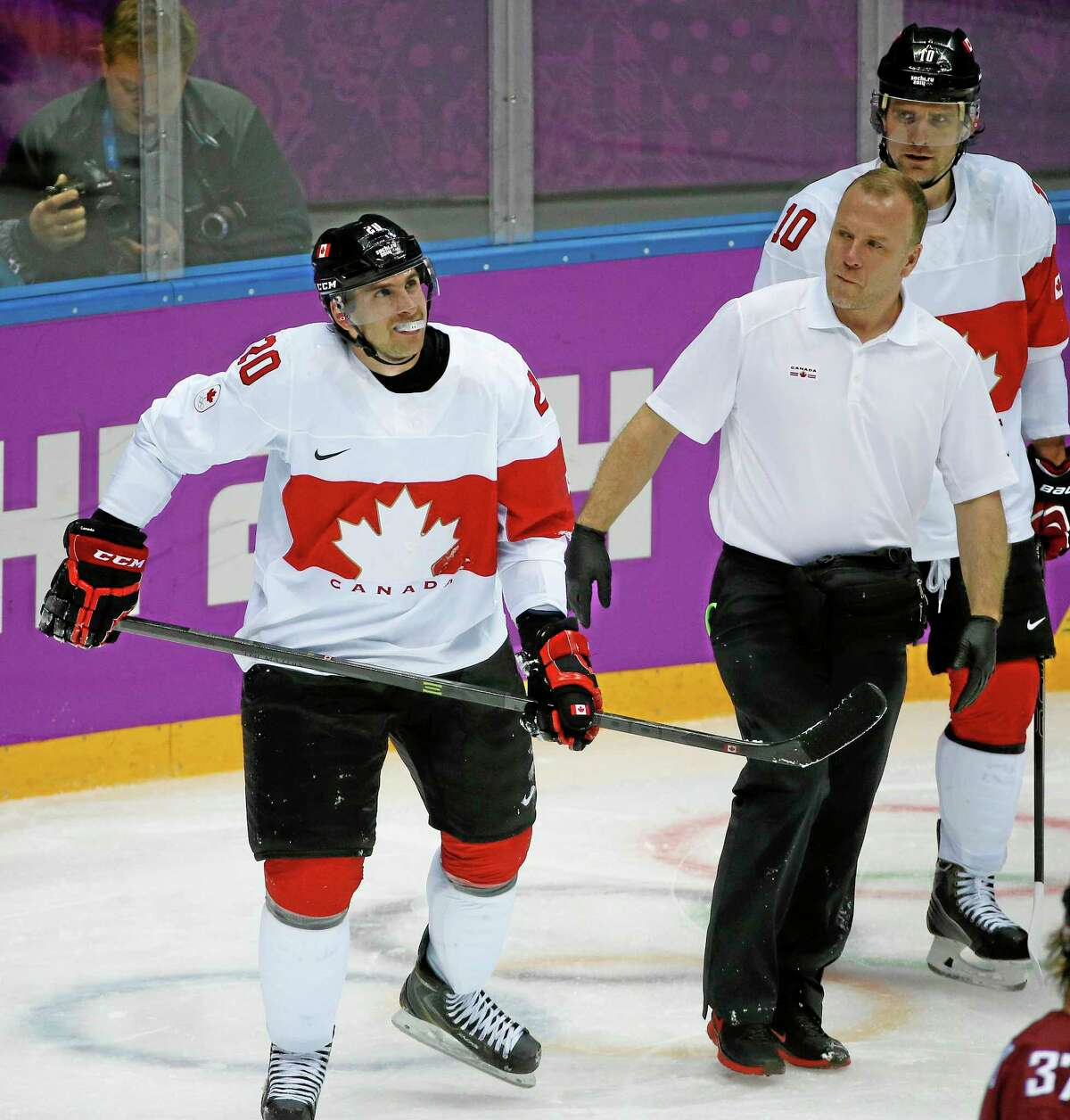 Canada forward John Tavares skates off the ice with a trainer after sustaining a knee injury during the second period of a men's quarterfinal game against Latvia at Winter Olympics last Wednesday in Sochi, Russia. The Islanders captain will not need surgery.