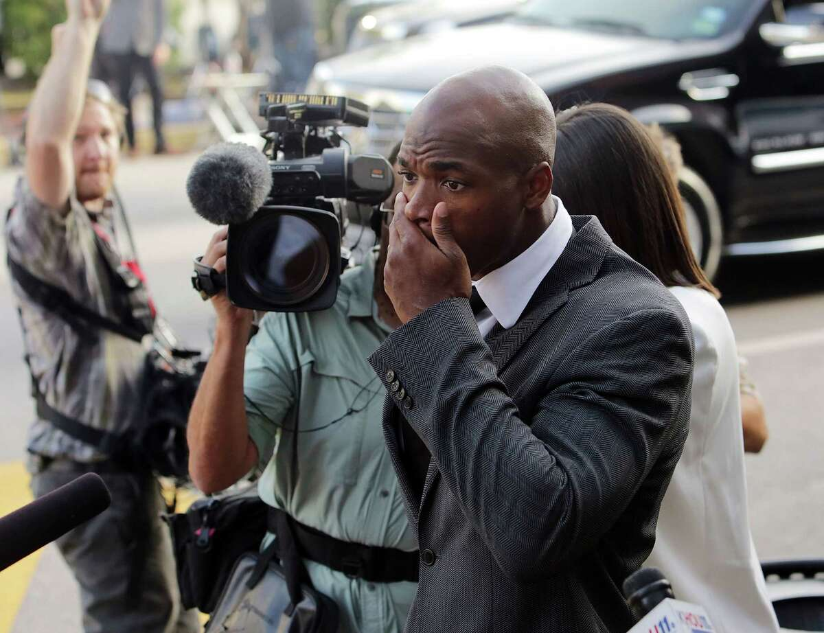 Minnesota Vikings running back Adrian Peterson arrives at court Wednesday in Conroe, Texas.