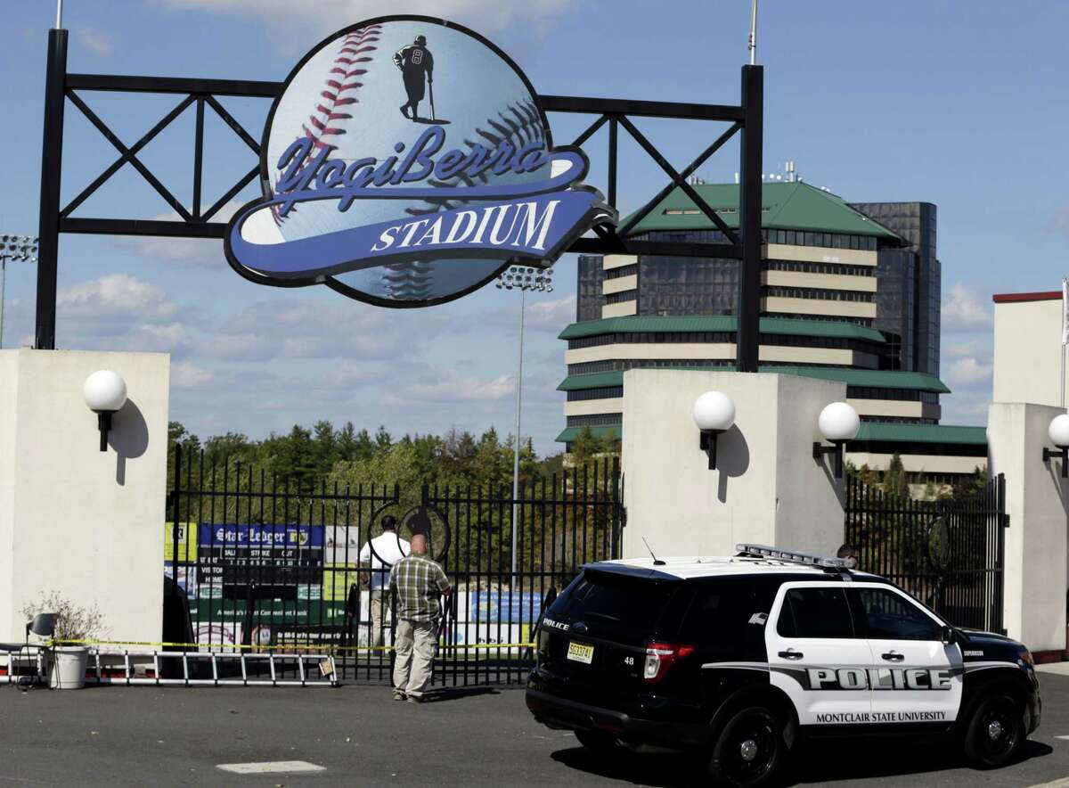 Montclair State University police officials investigate the main entrance to the Yogi Berra Stadium after a reported break-in on Wednesday in Montclair, N.J.