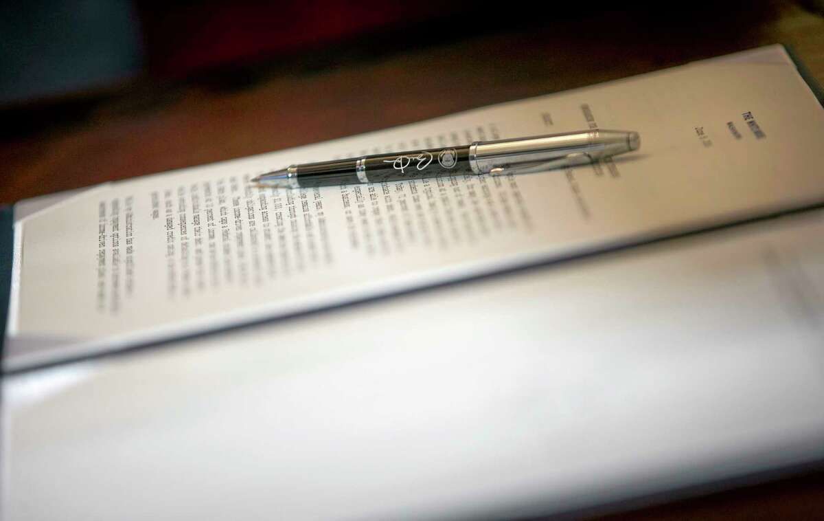 Close up the pen that President Barack Obama used to sign a Presidential Memorandum on reducing the burden of student loan debt, Monday, June 9, 2014 in East Room of the White House in Washington. The president said the rising costs of college have left America's middle class feeling trapped. He says no hard-working youngster in America should be priced out of a higher education. Obama signed a presidential memorandum he says could help an additional 5 million borrowers.(AP Photo/Pablo Martinez Monsivais)