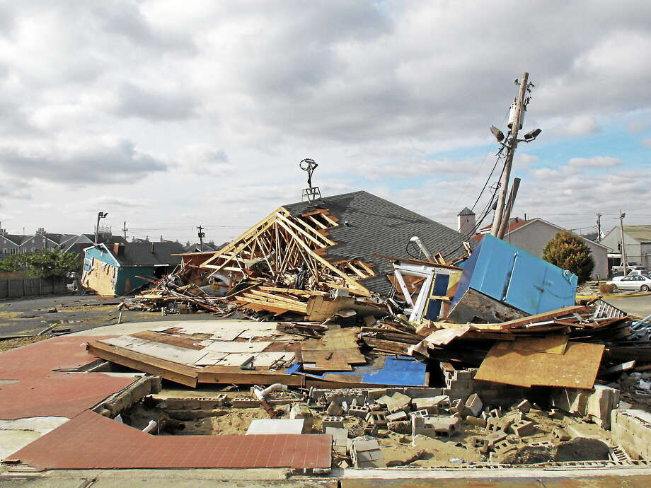 (AP Photo/Wayne Parry) This Nov., 15, 2012 photo shows the wreckage of a popular bar and restaurant in Sea Bright N.J. little more than two weeks after Superstorm Sandy pummeled the coast. Photo: AP / AP