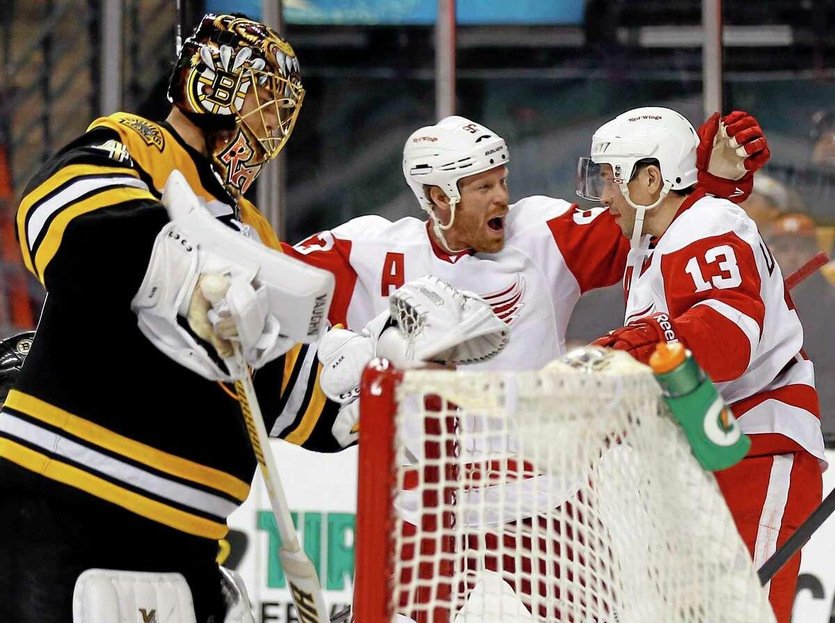 The Red Wings' Pavel Datsyuk (13) is congratulated by teammate Johan Franzen after scoring against Boston Bruins goalie Tuukka Rask, left, in Detroit's 1-0 victory.