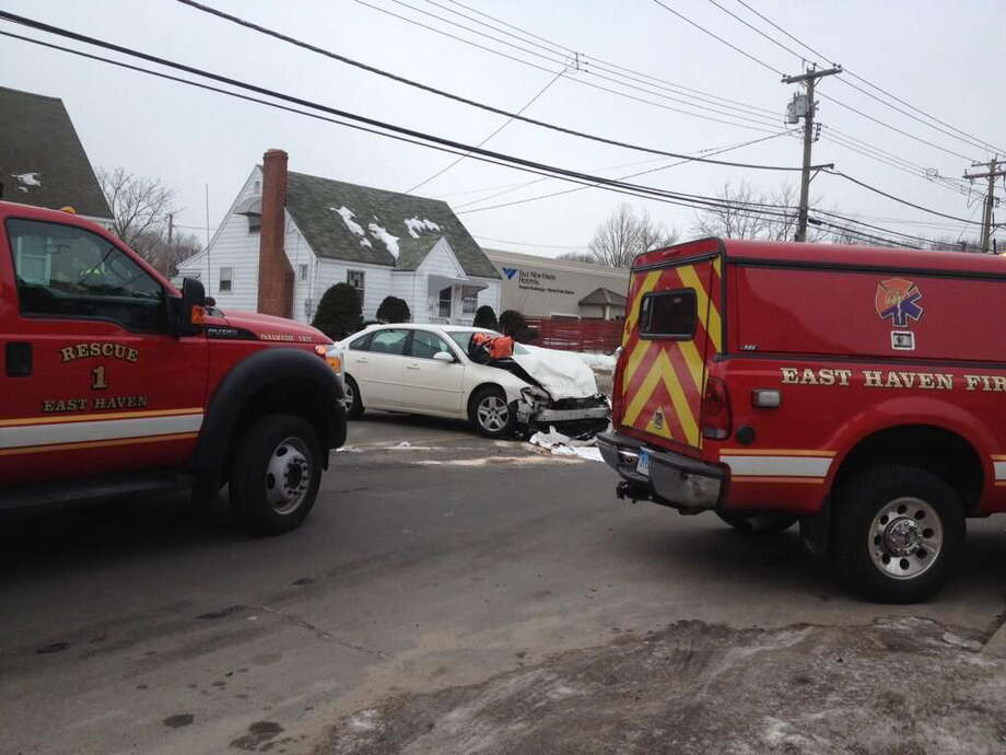 The scene of a head-on crash Tuesday on Main Street in East Haven. Photo: Charlotte Adinolfi — New Haven Register