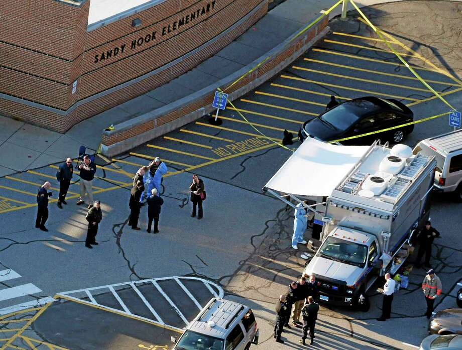 Officials on the scene outside of Sandy Hook Elementary School in Newtown, Conn., on Friday, Dec. 14, 2012. Photo: (Julio Cortez — The Associated Press) / AP