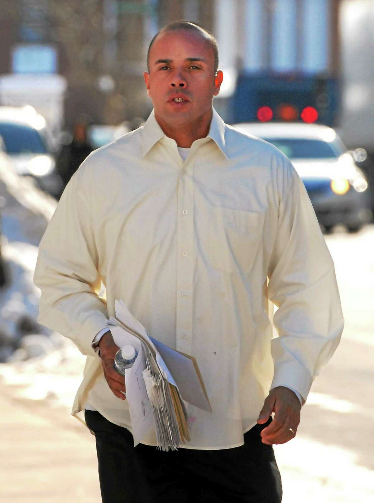 Angelo Reyes of New Haven runs to a hearing at Federal Court in Hartford in 2011.