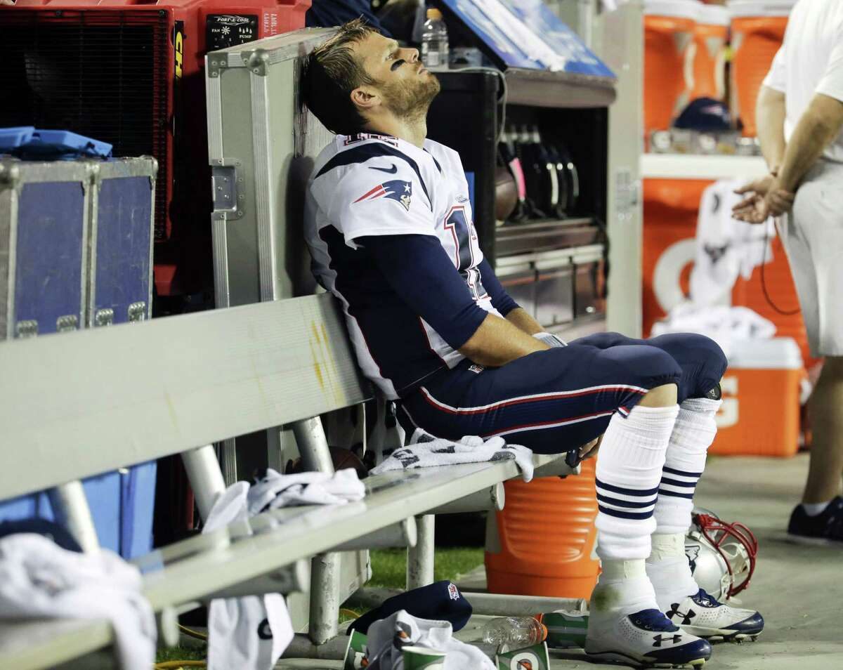 New England Patriots quarterback Tom Brady sits on the bench during the fourth quarter of a Sept. 29 game against the Chiefs in Kansas City, Mo.