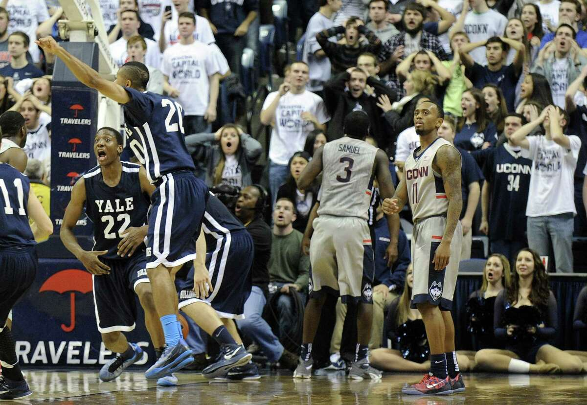 Connecticut's Ryan Boatright (11), players and fans react to Yale's game winning three point shot during the second half of Yale's 45-44 upset victory in an NCAA college basketball game in Storrs, Conn., on Sunday, Dec. 5, 2014. (AP Photo/Fred Beckham)