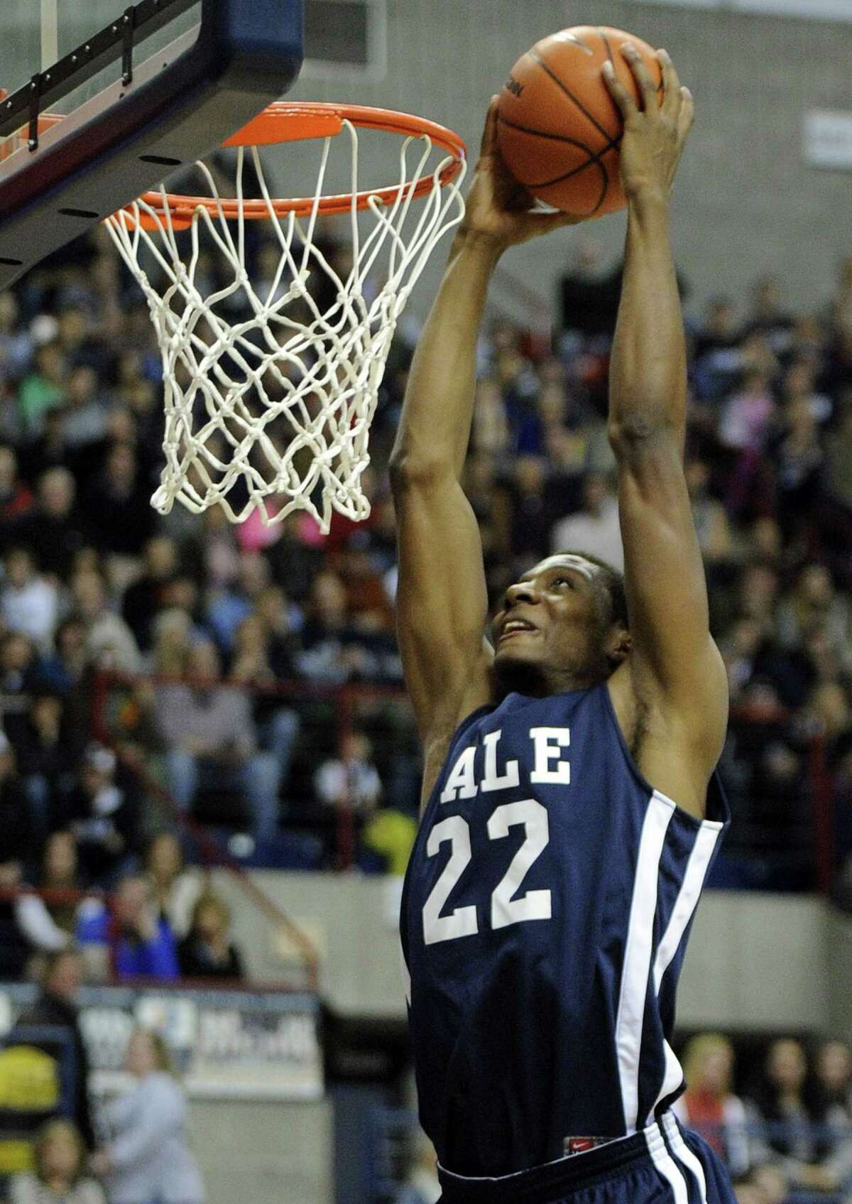 Yale's Justin Sears (22) scores against Connecticut during the first half of an NCAA college basketball game in Storrs, Conn., on Sunday, Dec. 5, 2014. (AP Photo/Fred Beckham)