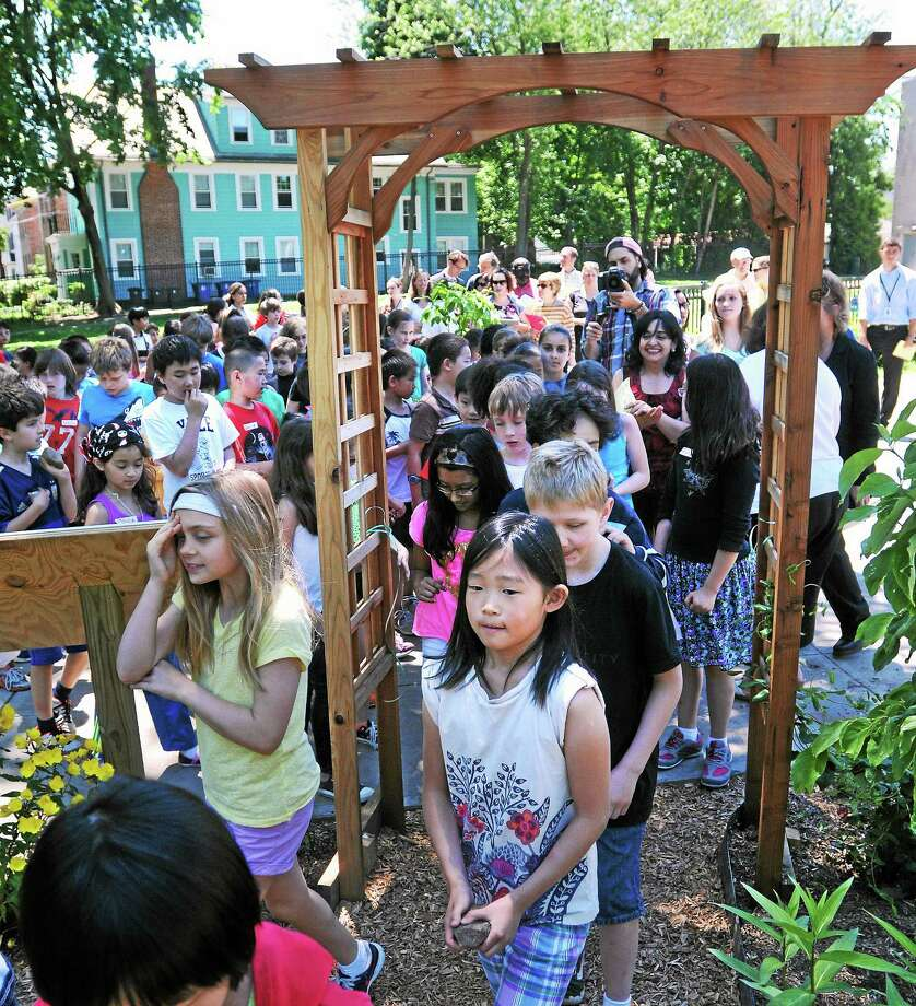 Students walk into the new Schoolyard Habitat gardens and outdoor classroom at Worthington Hooker School in New Haven. The garden features vegetables, flowers and an outdoor classroom. June 16, 2014. pcasolino@newhavenregister.com Photo: (Peter Casolino-New Haven Register)     / New Haven Register