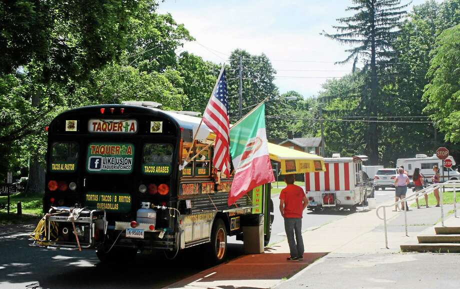 Food trucks Taqueria, foreground, and Som Siam in their new spot on Academy Street in Madison on Monday. Photo: SEAN CARLIN — NEW HAVEN REGISTER