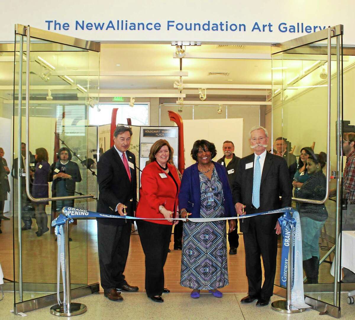 The Gateway Community College Foundation celebrates the official naming of the NewAlliance Foundation Art Gallery with the opening of the Memory and Legacy Holocaust Memorial Exhibit. Pictured, L to R: GCC Foundation Board Chair, Thomas Griggs Jr., Kim Healey, Executive Director of the NewAlliance Foundation, GCC President, Dorsey Kendrick, and NewAlliance Foundation Board Chair, Robert J. Lyons.