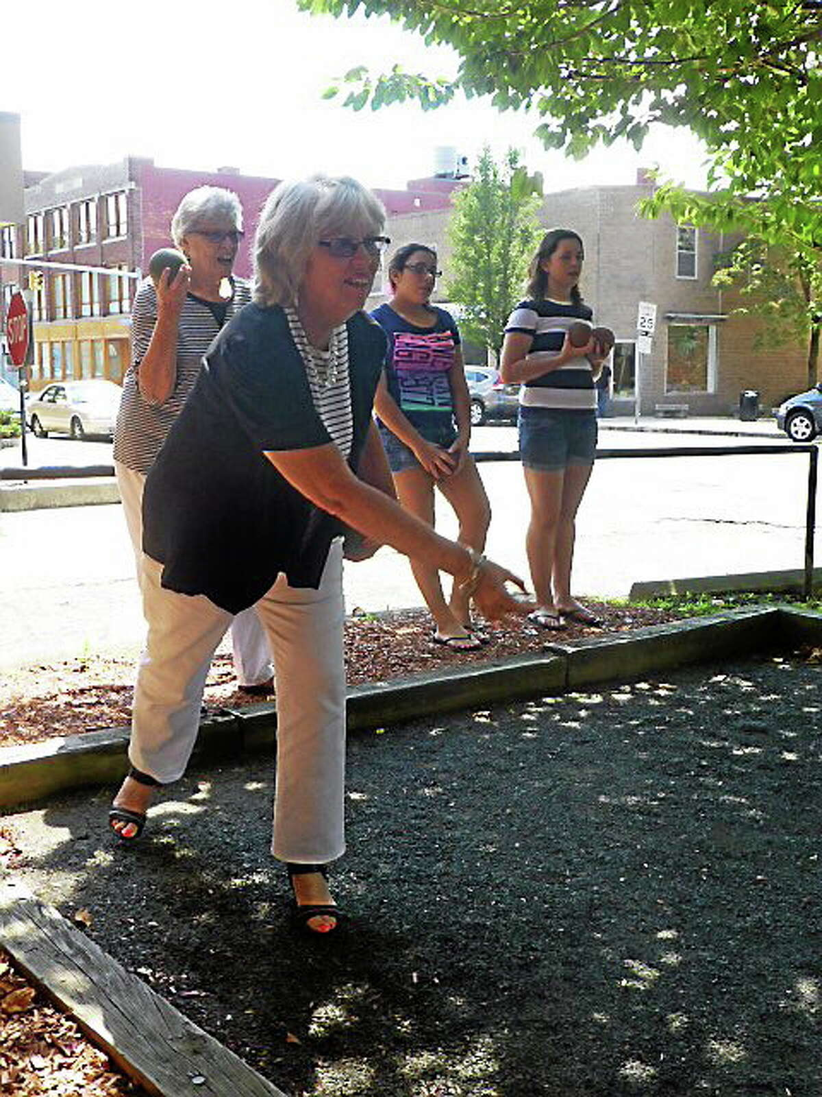 City Treasurer Judy Nicolari tries her hand at an informal bocce game Thursday during an intergenerational event at Doyle Senior Center in Ansonia Thursday.