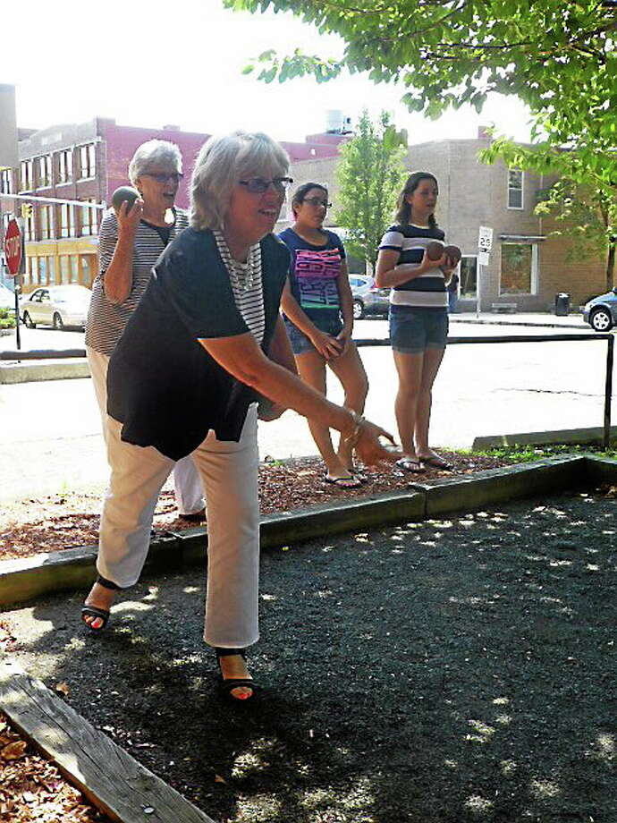 City Treasurer Judy Nicolari tries her hand at an informal bocce game Thursday during an intergenerational event at Doyle Senior Center in Ansonia Thursday. Photo: Patricia Villers — New Haven Register