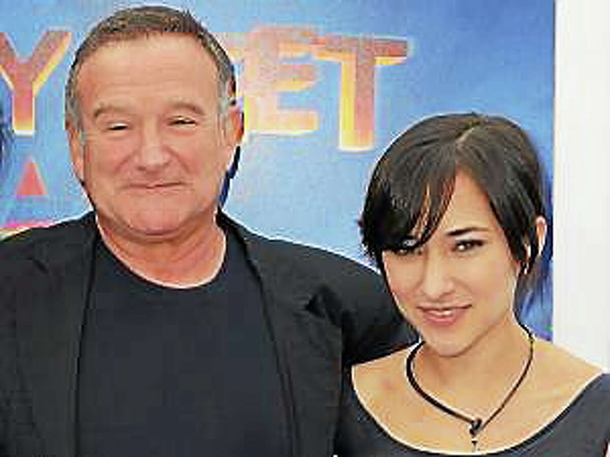 """This Nov. 13, 2011, file photo shows actor Robin Williams, left, and his daughter, Zelda at the premiere of """"Happy Feet Two"""" in Los Angeles."""