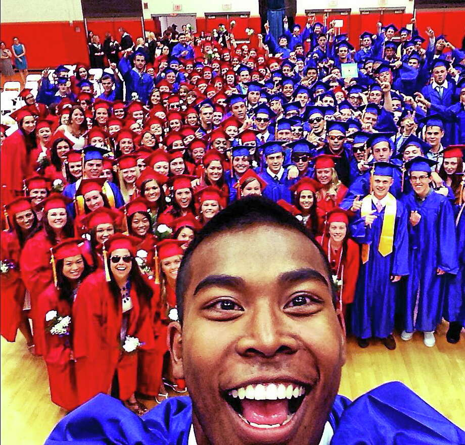 """Andy Khon of the Foran High School class of 2014 takes a """"selfie"""" photo with his smartphone of his graduating class before the start of commencement exercises Monday in Milford, Connecticut. Khon has been taking smartphone photos of himself with others his entire senior year and an exception was made by the school administration for this photo. Photo: CONTRIBUTED PHOTO — Andy Kohn   / ©Peter Hvizdak /  New Haven Register"""