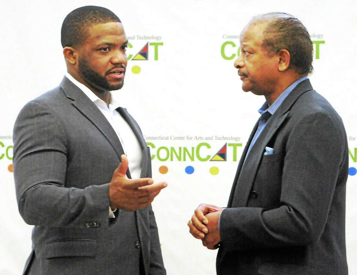 Maurice Clarett, an All-American running back who played at Ohio State University, left, and Carlton Highsmith, New Haven area entrepreneur and businessman, before Clarett speaks at ConnCat Tuesday in New Haven.