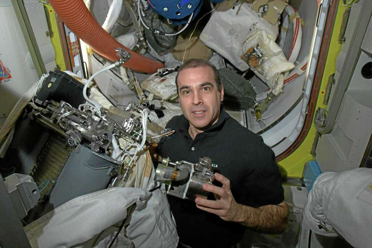 Astronaut Rick Mastracchio works to replace a pump in a spacesuit, April 14 aboard the International Space Station.
