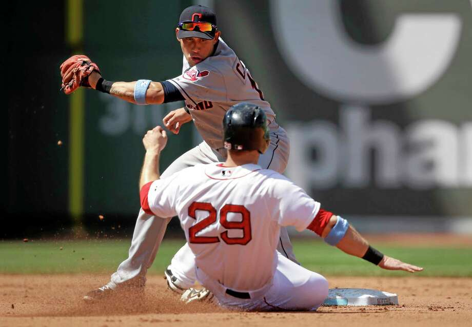 The Red Sox's Daniel Nava (29) is out on a steal attempt as Indians shortstop Asdrubal Cabrera, top, tags him in the fourth inning on Sunday. Photo: Steven Senne — The Associated Press   / AP