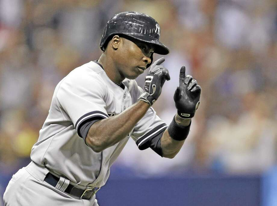The Yankees' Alfonso Soriano circles the bases after hitting a home run off Tampa Bay Rays starter David Price during the Yankees' 10-2 win. Photo: Chris O'Meara  — The Associated Press   / AP