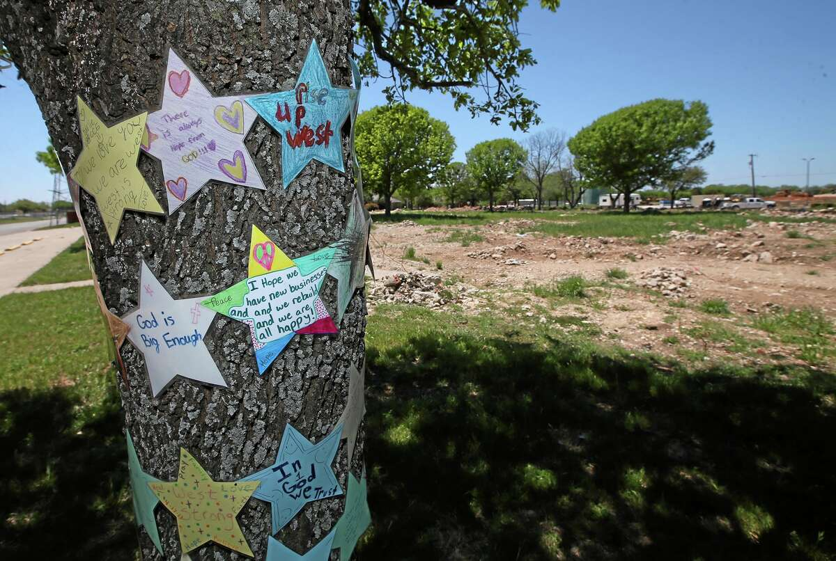 In this April 15, 2014 photo letters of hope are attached to a tree at the site of the old West Rest Haven nursing home that was destroyed in the West, Texas, Fertilizer Company a year earlier. On April 17, 2013, a fire at the plant caused a blast that caved in walls at nearby schools and homes, and sent debris flying for miles. (AP Photo/Waco Tribune Herald, Rod Aydelotte)