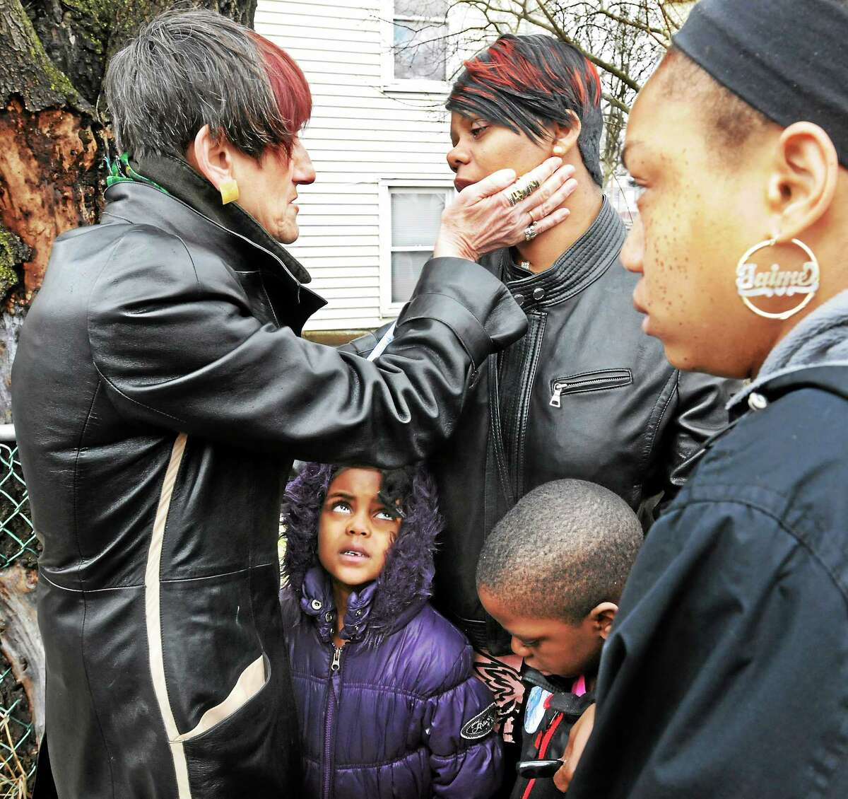 Congresswoman Rosa DeLauro, D-3, meets briefly March 30 with the mothers of sons killed by gunfire. Natasha Pettigrew, mother of Taijhon Washington, with her children Nyree Epps, 5, and Tyree Epps, 7, and Taijhon's cousin, Jaime Edwards.