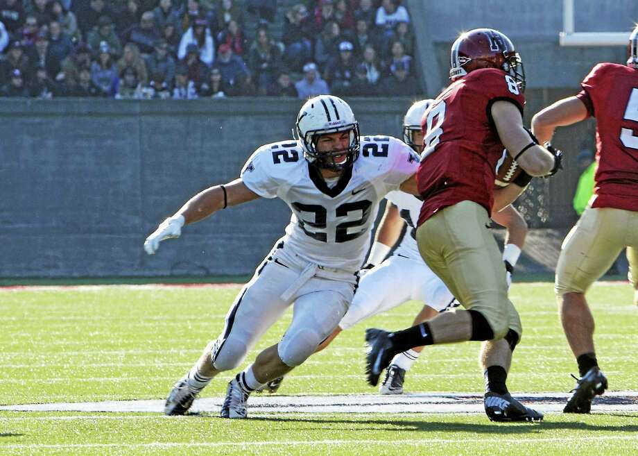 During the fall, Yale senior Charles Cook suits up for the Bulldogs' football team. Photo: Photo Courtesy Of Yale Athletics   / 2012 All Rights Reserved