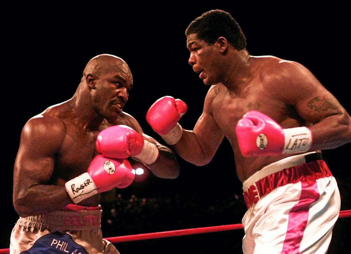 Heavyweights Evander Holyfield, left, and Riddick Bowe battle in the third round of their Nov. 4, 1995 fight at Caesars Palace in Las Vegas.