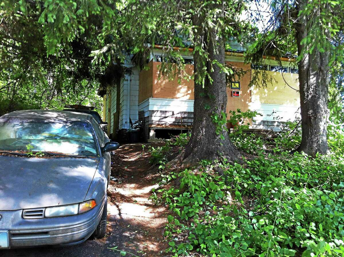 Wes Duplantier -- New Haven Register A 66-year-old Cheshire woman was found dead after the clutter on the first floor of her home collapsed into the basement. Neighbors who live across the street said they hadn't seen her in two weeks.