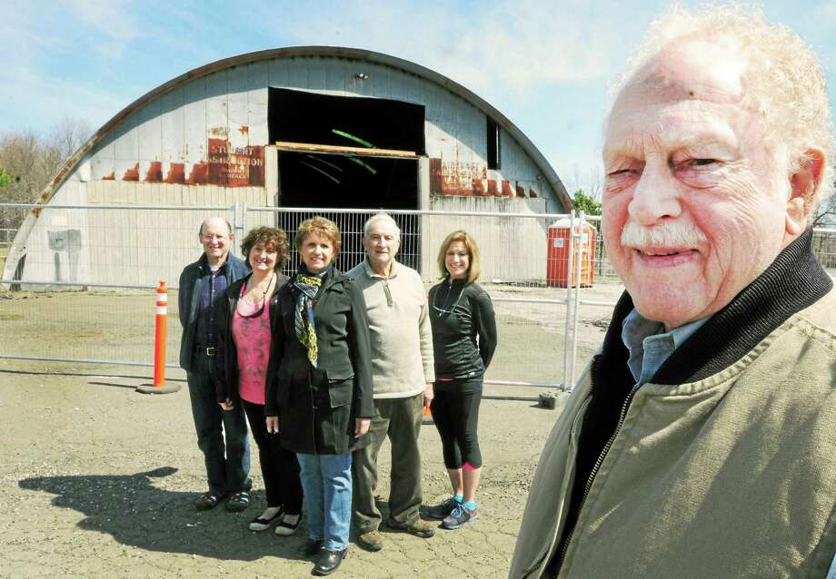 Airport Renovation Committee Chairman Art Slicer, right front, with, from left, David Gewirtz, Kathy Barone, Bethany First Selectman Derrylyn Gorski, Vincent Cofrancesco and Janice Howard, Bethany director of parks & recreation, are turning the historic Bethany Airport into a recreational center. Photo: Peter Hvizdak — New Haven Register      / ©Peter Hvizdak /  New Haven Register
