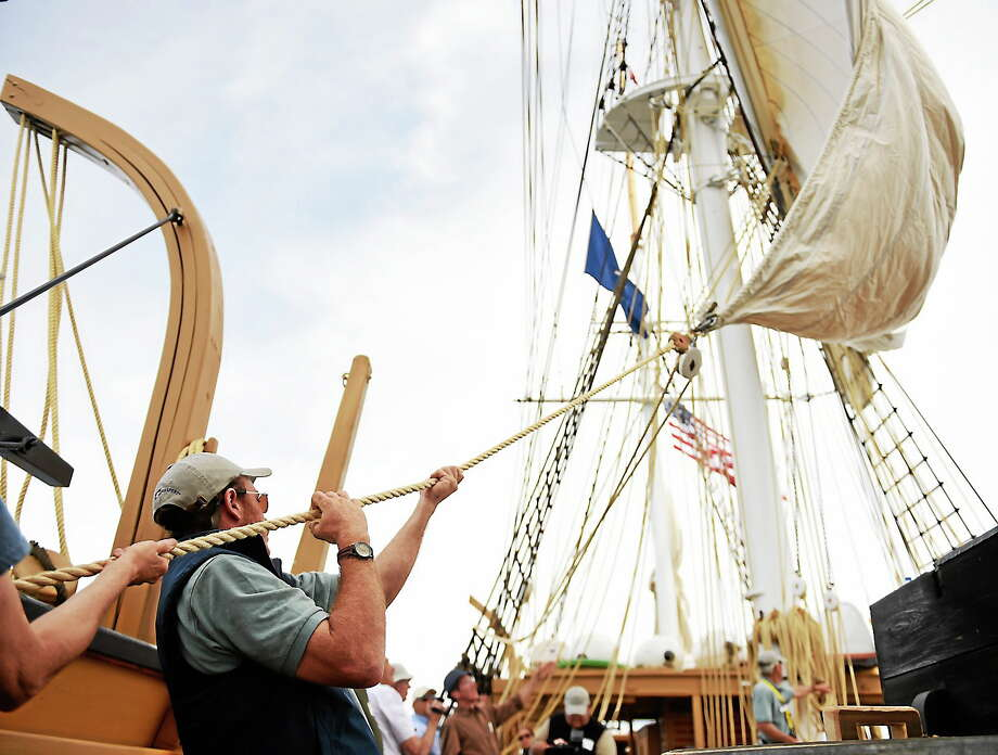 First mate Sam Sikkema helps set the main sail as the historic whaleship Charles W. Morgan tacks on the second of four sea trials day sails, its first time under sail since 1922 on June 8, 2014 out of New London, Conn. Photo: AP Photo/The Day, Sean D. Elliot   / THE DAY